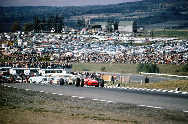 Watkins Glen, New York, USA. 30/9-2/10 1966. Lorenzo Bandini (Ferrari 312), retired, leads Jim Clark (Lotus 43 BRM) 1st position, action. Ref: 66 USA 01 World Copyright - LAT Photographic