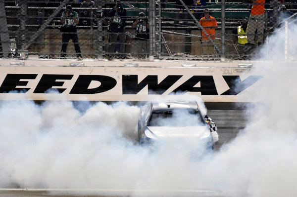 Monster Energy NASCAR Cup Series Go Bowling 400 Kansas Speedway, Kansas City, KS USA Saturday 13 May 2017 Martin Truex Jr, Furniture Row Racing, Auto-Owners Insurance Toyota Camry celebrates his win with a burnout World Copyright: Nigel Kinrade LAT Images ref: Digital Image 17KAN1nk10402