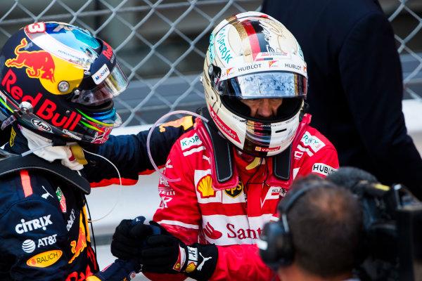 Monte Carlo, Monaco. Sunday 28 May 2017. Daniel Ricciardo, Red Bull Racing, 3rd Position, congratulates Sebastian Vettel, Ferrari, 1st Position, in Parc Ferme. World Copyright: Sam Bloxham/LAT Images ref: Digital Image _W6I5405