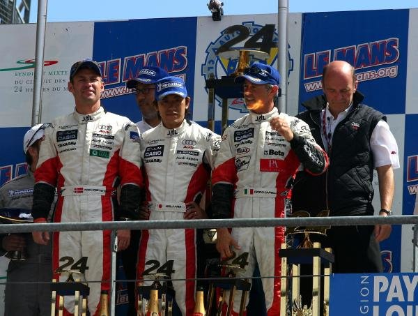 Tom Kristensen (DEN) / Seiji Ara (JPN) / Rinaldo Capello (ITA) Audi Sport Japan Team Goh Audi R8 on the podium after winning the 24 Hours of Le Mans.