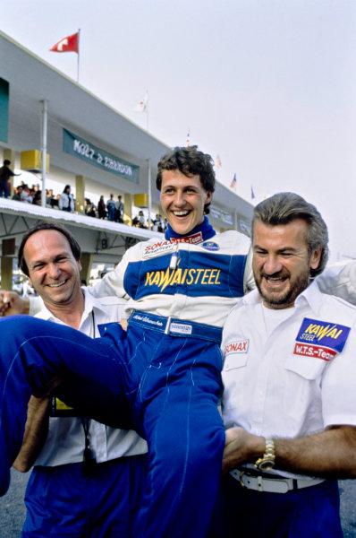 1990 Macau Formula 3 Grand Prix.  Macau, China. 25th November 1990. Michael Schumacher (Reynard 903-Volkswagen), 1st position, carried by Manager Willi Weber, portrait.  World Copyright: LAT Photographic.  Ref: 90F3MAC06.