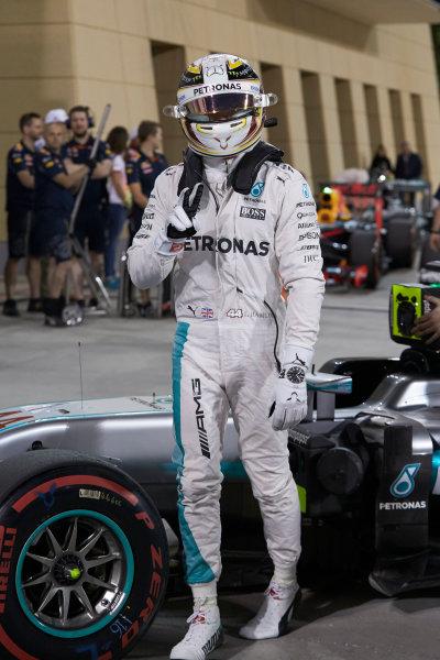 Bahrain International Circuit, Sakhir, Bahrain. Saturday 2 April 2016. Lewis Hamilton, Mercedes AMG, celebrates pole in Parc Ferme. World Copyright: Steve Etherington/LAT Photographic ref: Digital Image SNE25189