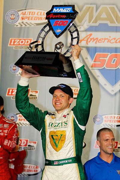 14-15, September, 2012, Fontana, California, USAEd Carpneter hoists the winners trophy at the MAVTV 500.(c) 2012, Perry NelsonLAT Photo USA
