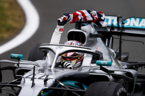 Race winner Lewis Hamilton, Mercedes AMG F1 W10 with a flag