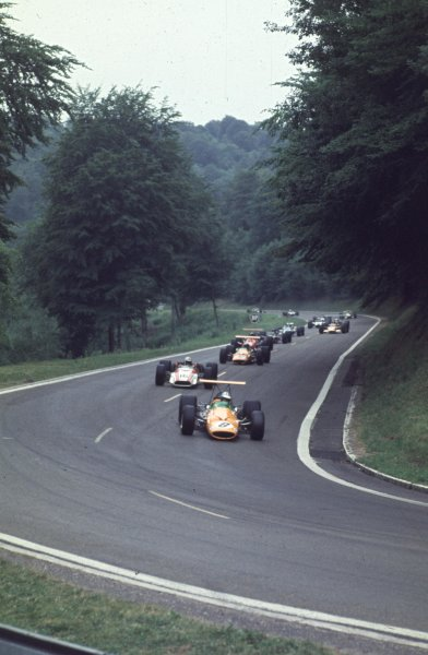 1968 French Grand Prix.Rouen-Les-Essarts, France.5-7 July 1968.Denny Hulme (McLaren M7A Ford) leads John Surtees (Honda RA301) and Bruce McLaren (McLaren M7A Ford).Ref-68 FRA 05. They finished in 5th, 2nd and 8th positions respectively.World Copyright - LAT Photographic