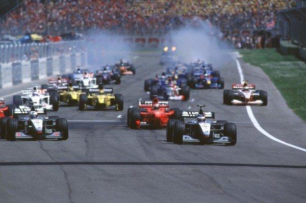 1999 San Marino Grand Prix.Imola, Italy. 30/4-2/5 1999.Mika Hakkinen and David Coulthard (both McLaren MP4/14 Mercedes-Benz) lead at the start.World Copyright - LAT Photographic