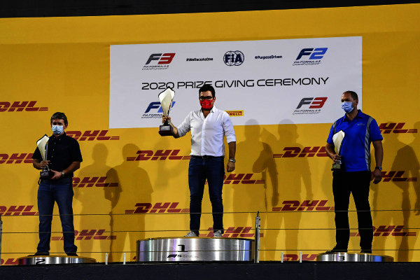 F2 Championship Top 3 Constructor Representatives, Rene Rosin of Prema, Andy Roche of Uni-Virtuosi and Carlin celebrate on the podium with the trophies