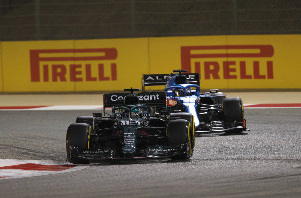 Lance Stroll, Aston Martin AMR21, leads Fernando Alonso, Alpine A521
