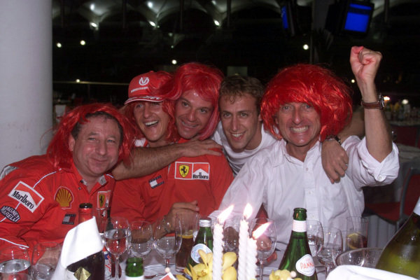 Jean Todt, Michael Schumacher, Rubens Barrichello, Luca Badoer and Luca di Montezemolo celebrate another Ferrari world championship.