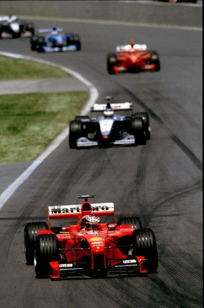 1999 Canadian Grand Prix.Montreal, Quebec, Canada.11-13 June 1999.Michael Schumacher (Ferrari F399) leads Mika Hakkinen (McLaren MP4/14 Mercedes).Ref-99 CAN 10.World Copyright - LAT Photographic