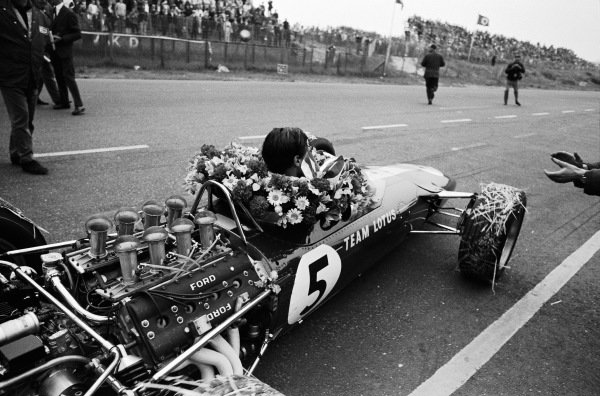 Jim Clark, Lotus 49 Ford, celebrates victory on the debut of the Ford DFV engine.