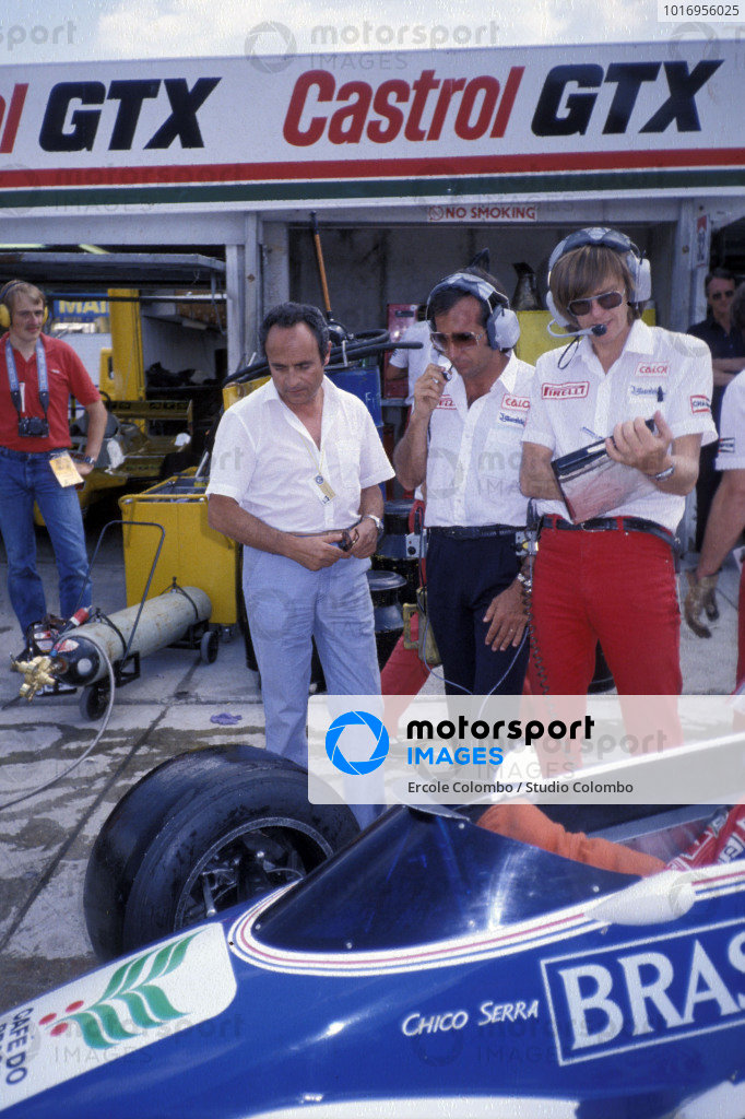 Emerson Fittipaldi (centre) with other members of the Fittipaldi team in the pits. Richard Divila, designer