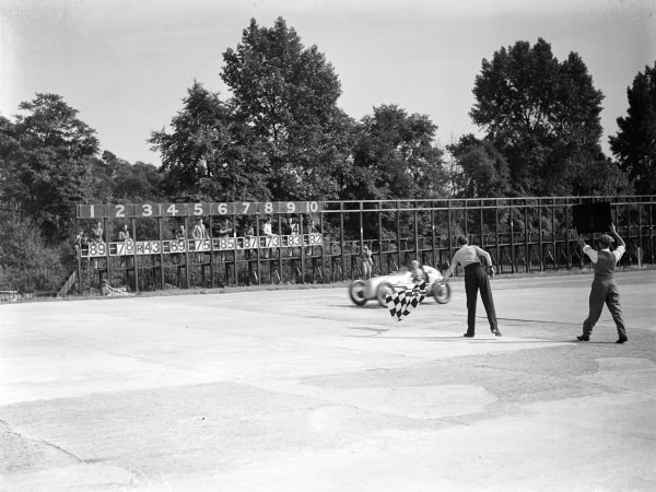 Kay Petre, Austin, crosses the line and takes the chequered flag.