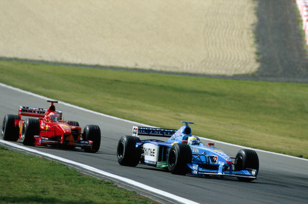 1999 European Grand Prix.Nurburgring, Germany. 24-26 September 1999.Giancarlo Fisichella (Benetton B199 Playlife) followed by Eddie Irvine (Ferrari F399).World Copyright - LAT Photographic