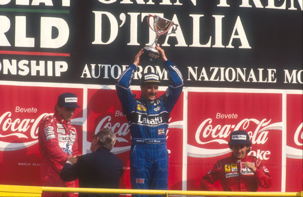 1991 Italian Grand Prix.Monza, Italy.6-8 September 1991.Nigel Mansell (Williams Renault) celebrates 1st position with his two great rivals Ayrton Senna (McLaren Honda) 2nd position (with FIA President Jean-Marie Balestre) and Alain Prost (Ferrari) 3rd position on the podium.Ref-91 ITA 21.World Copyright - LAT Photographic