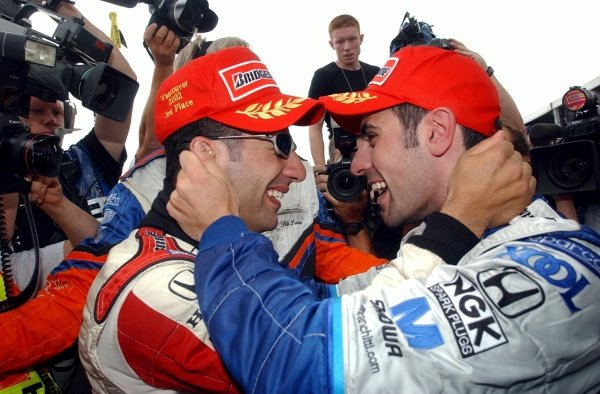 Tony Kanaan (BRA) Mo Nunn Racing, left, and winner Dario Franchitti (GBR) Team Kool Green, right, celebrate finishing 3rd and 1st respectively  Digital Image CART FedEx World Series, Rd10, Concord Pacific Place, Vancouver, Canada,  28 July 2002. DIGITAL IMAGE
