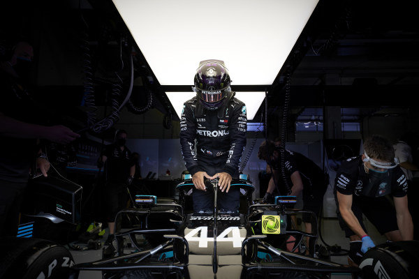 Lewis Hamilton, Mercedes F1 W11 EQ Performance, climbs in to his car in the garage