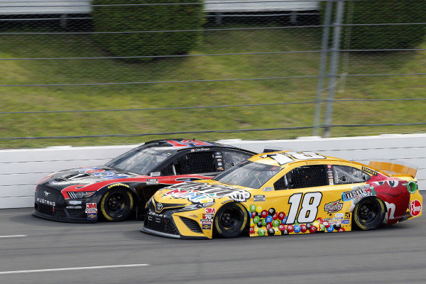 #14: Clint Bowyer, Stewart-Haas Racing, Ford Mustang Mobil 1 and #18: Kyle Busch, Joe Gibbs Racing, Toyota Camry M&M's Mini's