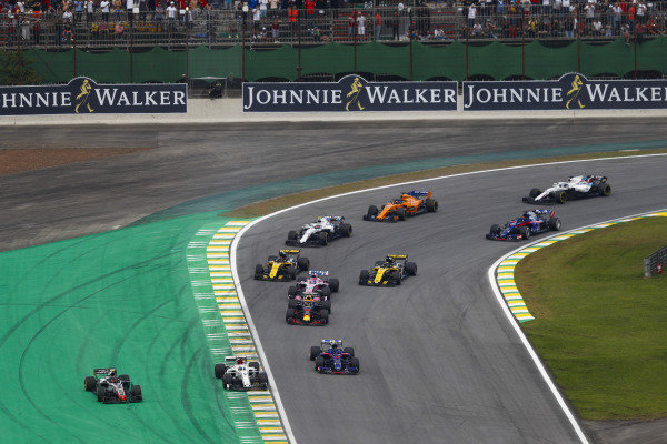 Kevin Magnussen, Haas F1 Team VF-18 Ferrari, and Marcus Ericsson, Sauber C37 Ferrari, run wide ahead of Pierre Gasly, Toro Rosso STR13 Honda.