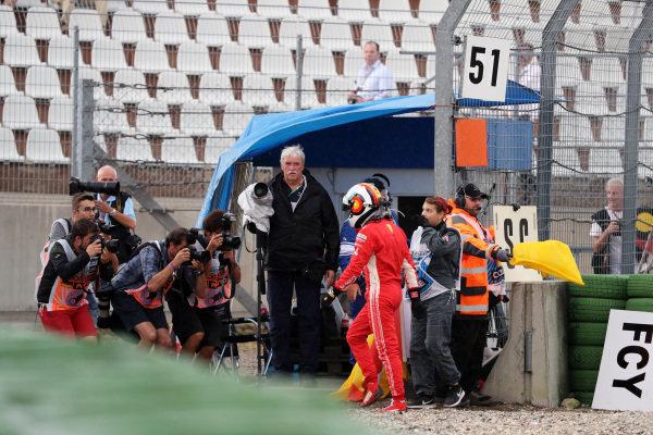 Sebastian Vettel (GER) Ferrari SF-71H walks in after crashing out of the race