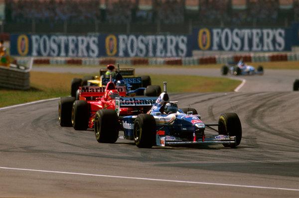 Buenos Aires, Argentina.11-13 APRIL 1997.Heinz-Harald Frentzen (Williams FW19 Renault) leads Eddie Irvine (Ferrari F310B) into Curva de la Confiteria.Ref-97 ARG 04.World Copyright - LAT Photographic