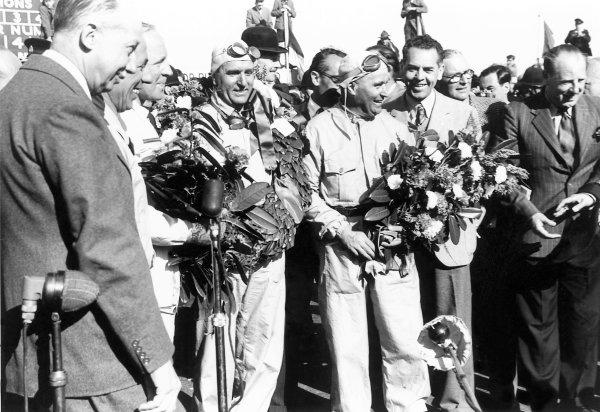 1950 British Grand Prix.Silverstone, Great Britain. 13th May 1950.Giuseppe Farina and Luigi Fagioli on the podium.World Copyright: LAT Photographicref: 3734L/10