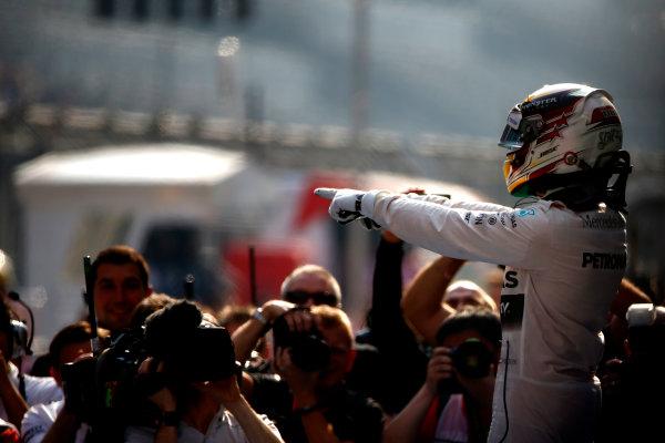 Shanghai International Circuit, Shanghai, China. Sunday 12 April 2015. Lewis Hamilton, Mercedes AMG, 1st Position, celebrates on arrival in Parc Ferme. World Copyright: Andrew Hone/LAT Photographic. ref: Digital Image _ONZ1029
