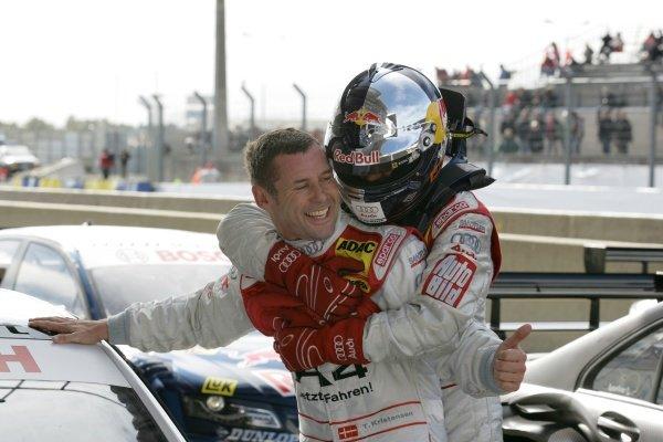 L-R: Tom Kristensen (DEN) Audi Sport Team Abt  Audi A4 DTM (2008) is congratulated on his pole position by Mattias Ekstrom (SWE) Audi Sport Team Abt Sportsline  Red Bull Audi A4 DTM (2008).DTM, Rd10, Le Mans Bugatti Circuit, Le Mans, France, 3-5 October 2008.