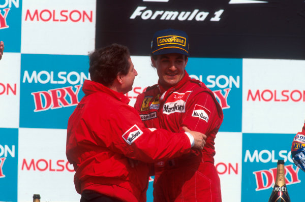 Montreal, Quebec, Canada.9-11 June 1995.Jean Alesi (Ferrari) with team boss Jean Todt celebrates his maiden Grand Prix win on the podium.Ref-95 CAN 03.World Copyright - LAT Photographic