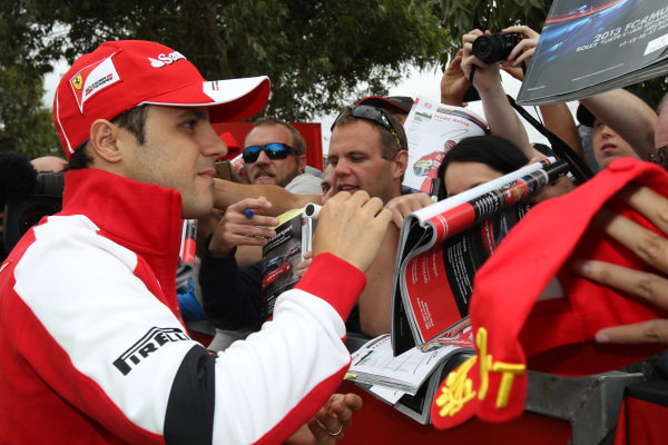 Felipe Massa (BRA) Ferrari signs autographs for the fans. Formula One World Championship, Rd1, Australian Grand Prix, Preparations, Albert Park, Melbourne, Australia, Thursday 14 March 2013.
