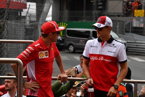 Kimi Raikkonen (FIN) Ferrari and Marcus Ericsson (SWE) Alfa Romeo Sauber F1 Team on the drivers parade