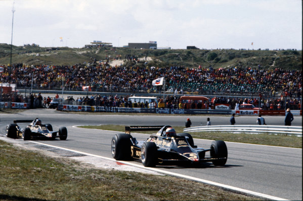 Zandvoort, Holland. 25-27 August 1978. Mario Andretti (Lotus 79-Ford), 1st position, leads Ronnie Peterson (Lotus 79-Ford), 2nd position, action.  World Copyright: LAT Photographic. Ref: 78HOL28
