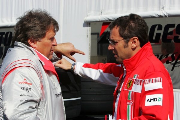 (L to R): Norbert Haug (GER) Mercedes Sporting Director talks with Stefano Domenicali (ITA) Ferrari Manager of F1 Operations. Formula One World Championship, Rd 8, French Grand Prix, Practice Day, Magny-Cours, France, Friday 29 June 2007.
