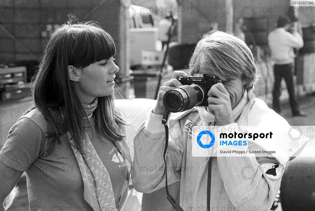 Seventh placed Jacques Laffite (FRA) Ligier, tries his hand at photography using a Nikomat. Japanese Grand Prix, Rd 16, Fuji, Japan, 24 October 1976.