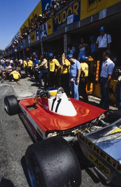 Carlos Reutemann, Ferrari 312T3 sits in the pitlane.
