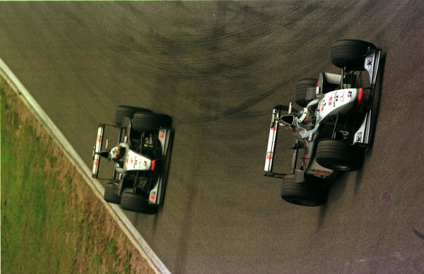 1998 German Grand Prix.Hockenheim, Germany.31/7-2/8 1998.Mika Hakkinen leads David Coulthard (both McLaren MP4/13 Mercedes-Benz). They finished in 1st and 2nd positions respectively.World Copyright - LAT Photographic