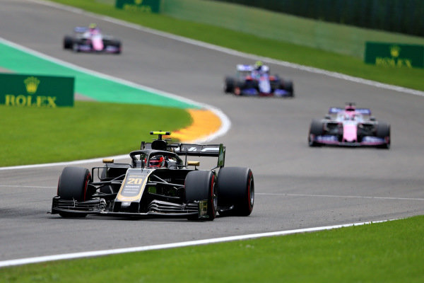 Kevin Magnussen, Haas VF-19, leads Sergio Perez, Racing Point RP19