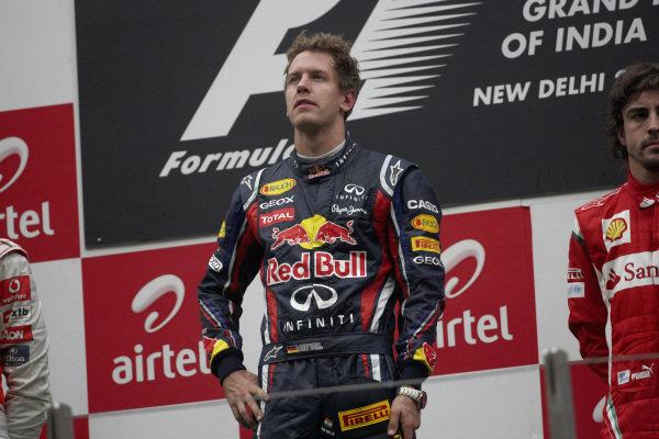 Sebastian Vettel, 1st position, on the podium.