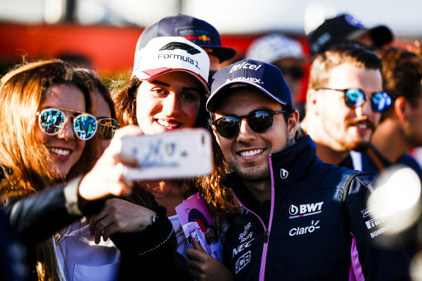 Sergio Perez, Racing Point poses for a seflie with a fan