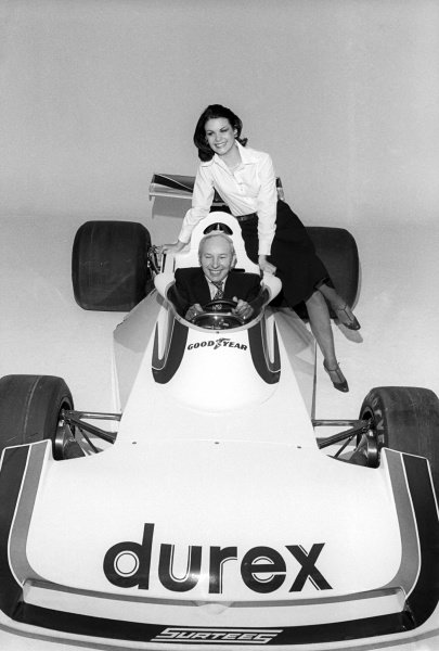 John Surtees (GBR) Surtees Team Owner unveils the Surtees TS19, which featured sponsorship livery from condom manufacturer Durex. Formula One World Championship, England, c. Early 1976.