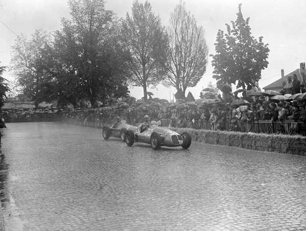 Louis Chiron, Maserati 4CLT-48, leads Juan Manuel Fangio, Alfa Romeo 159.