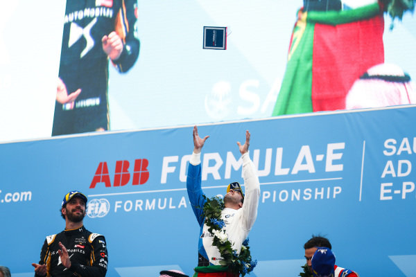 Antonio Felix da Costa (PRT), BMW I Andretti Motorsports throws his winner's trophy into the air as Jean-Eric Vergne (FRA), DS TECHEETAH watches on
