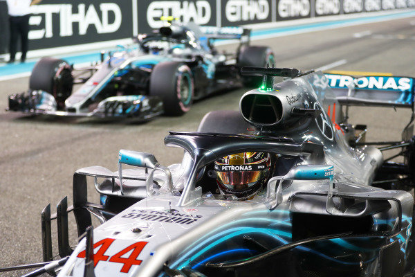 Lewis Hamilton, Mercedes AMG F1 W09 EQ Power+, and Valtteri Bottas, Mercedes AMG F1 W09 EQ Power+, return to the grid after qualifying.