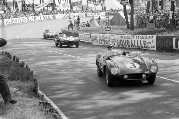 Umberto Maglioli / Phil Hill, Scuderia Ferrari, Ferrari 121 LM, leads Don Beauman / Norman Dewis, Jaguar Cars, Jaguar D-type, and Mike Hawthorn / Ivor Bueb, Jaguar Cars, Jaguar D-type.