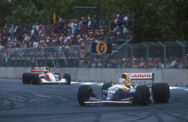1992 Australian Grand Prix.Adelaide, Australia.6-8 November 1992.Nigel Mansell (Williams FW14B Renault) leads Ayrton Senna (McLaren MP4/7A Honda). They both exited the race whilst leading, when Senna hit Mansell from behind on lap 19.Ref-92 AUS 29.World Copyright - LAT Photographic