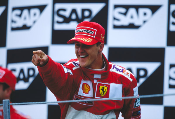 2000 United States Grand Prix.Indianapolis, Indiana, USA. 22-24 September 2000.Michael Schumacher (Ferrari) celebrates his 1st position on the podium.Ref-2K USA 40.World Copyright - LAT Photographic