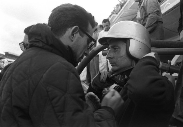 Nino Vaccarella listens to instructions from Mauro Forghieri during a pit stop.