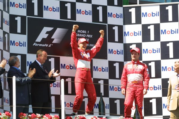 2001 French Grand Prix - RaceMagny-Cours, France. 1st July 2001Michael Schumacher, Ferrari F2001, celebrates his 50th GP win with team mate Rubens Barrichello, Ferrari F2001 (3rd) - podium.World Copyright - LAT Photographicref: 8 9 MB Digital File only
