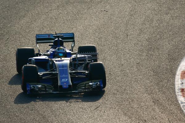Circuit de Barcelona Catalunya, Barcelona, Spain. Monday 27 February 2017. Marcus Ericsson, Sauber C36 Ferrari, carries sensor equipment.  World Copyright: Zak Mauger/LAT Images ref: Digital Image _L0U9699