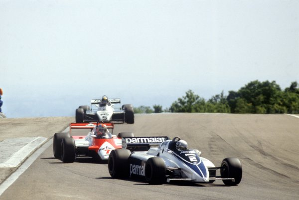 1982 Swiss Grand Prix.Dijon-Prenois, France. 29 August 1982.Riccardo Patrese, Brabham BT50-BMW, 5th position, leads John Watson, McLaren MP4/1B-Ford, 13th position, and Derek Daly, Williams FW08-Ford, 9th position, action.World Copyright: LAT PhotographicRef: 35mm transparency 82SWI23